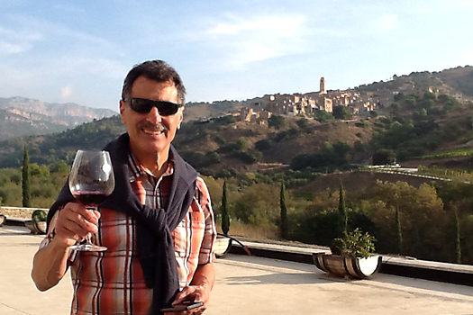 Tasting wine at Bodegas Mas Alta - The village Vilella Alta in the background